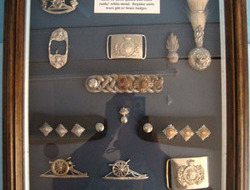 Volunteer Artillery' Badges And Insignia 1859-1908. A large frame of. 'Volunteer Artillery' Badges And Insignia 1859-1908.