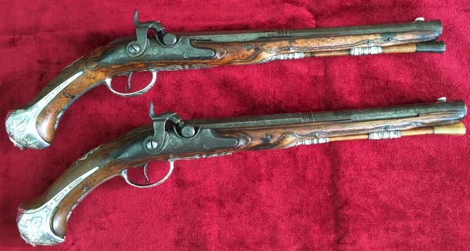 Attractive pair of long silver mounted pistols. Originally made as flintlocks, later converted to Percussion. Ref 8603 Pistol / Hand Guns