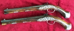 Attractive pair of long silver mounted pistols. Originally made as flintlocks, later converted to Percussion. Ref 8603   Muzzleloader for sale in United Kingdom