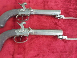 Pair of percussion  travelling pistols fitted with spring bayonets by G & J DEANE LONDON. Ref 9405   Muzzleloader