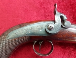 A scarce Irish single shot percussion pistol with Octagonal barrel and a Captive Ramrod. Engraved W. RIGBY, DUBLIN. Good condition. Ref 9584.   Muzzleloader