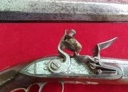 A rare Irish flintlock duelling pistol with TUTANAG mounts, made by Dory of Mallow. Ref 1409.   Muzzleloader