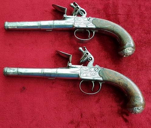 A fine pair of silver mounted English Queen Anne style flintlock box-lock pistols by Ketland & Co London. Good condition. Ref 9938. Pistol / Hand Guns