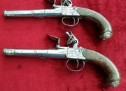 Ref 9938. A fine pair of silver mounted English Queen Anne style flintlock box-l pistols by Ketland & Co London. Good condition.   Muzzleloader