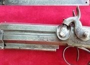 A very good example of a double barrel over under percussion pistol by Charles Lancaster. Ref 1669.   Muzzleloader