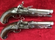 A fine pair of 18th century Silver Mounted Miquelet Pistols. Noble family crest embossed in the silver work. Good condition. Ref 9260.   Muzzleloader