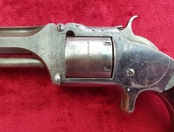 A good American tip up .32 rim-fire revolver made by the world famous Smith & Wesson of Springfield Mass. C. 1870. Ref 9749.   Revolver
