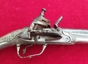 Ref 2562. A rare Greek Miquelet  pistol with a solid silver covered stock. Good condition.   Muzzleloader