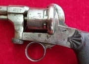 Ref 2801. A very unusual 6 shot double action 7mm pin-fire revolver with a ring trigger. Good cond.   Muzzleloader