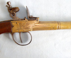 Brass Flintlock Travelling Pistol With Cannon Barrel & Walnut Slab Grip.