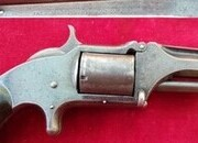 Ref 2594. A Smith & Wesson tip-up .32 rimfire revolver with a leather holster. holster. Ref 2594   Revolver