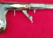 Ref 7415. A scarce silver inlaid American 19th Century Boot -Leg style percussion underhammer pistol.   Muzzle loader